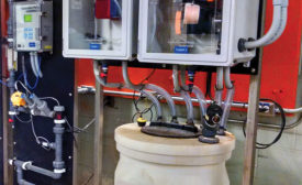 This sodium hypochlorite feed system has an ORP probe and Internet-enabled controller.