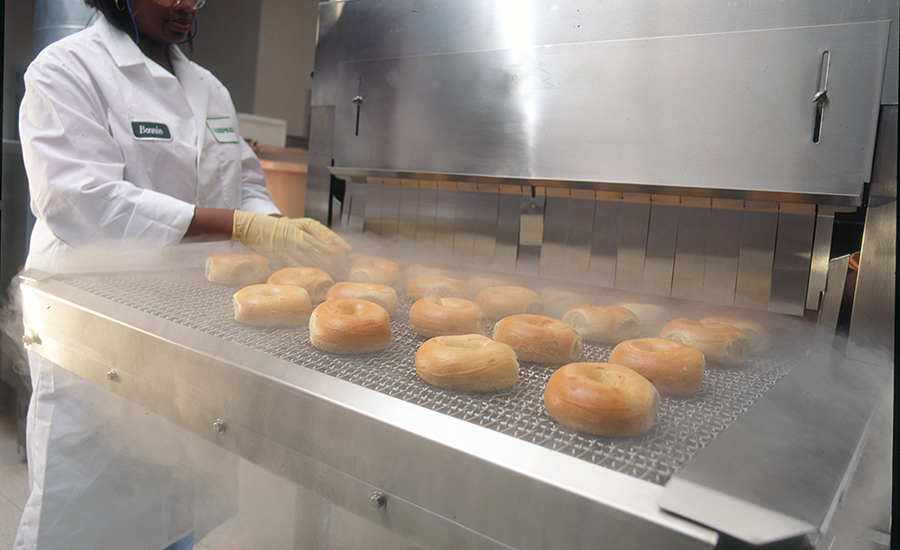 a worker freezing bagels